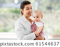 female pediatrician doctor with baby at clinic 61544637
