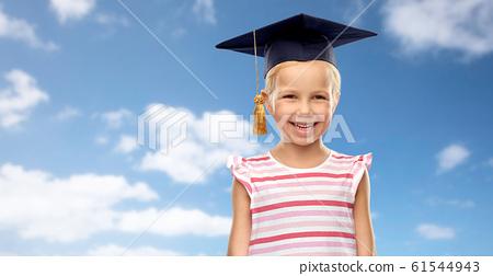 happy girl in bachelor hat or mortarboard over sky 61544943