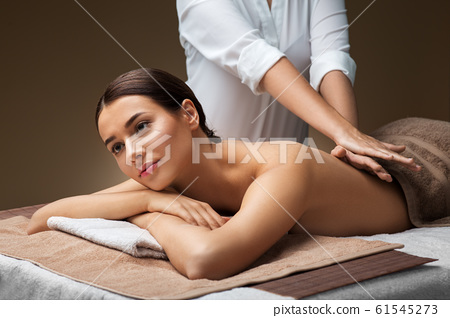 woman lying and having back massage at spa 61545273