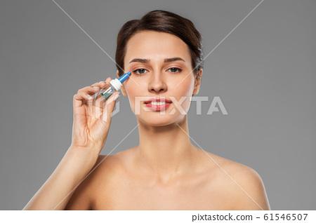 beautiful young woman with eye drops 61546507
