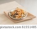 Crispy fried salmon skin on wooden table 61551485