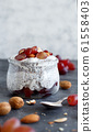 Chia pudding parfait with red grapes and almonds 61558403