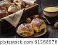 Homemade cinnamon and walnut swirl buns. 61568976