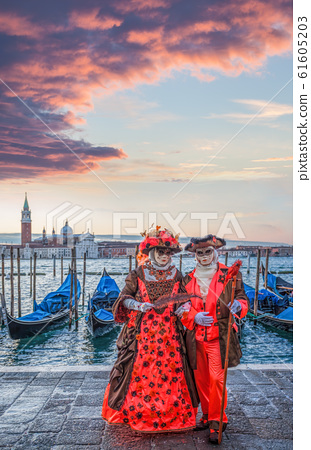 Colorful carnival masks at a traditional festival in Venice, Italy 61605203