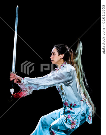 woman Tai Chi Chuan Tadjiquan posture isolated black background light painting 61611958