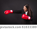 strong business woman punching, powerful impact on 61633389