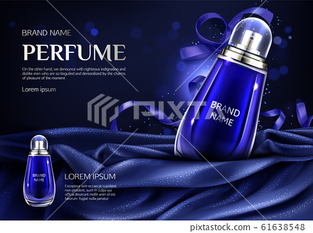 Perfume glass bottle on blue silk folded fabric 61638548