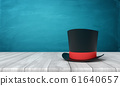 3d rendering of black tophat with red ribbon standing on wooden table near blue wall with copy space. 61640657