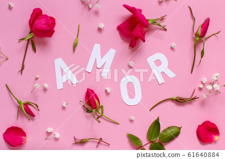 Red roses and text AMOR on a light pink background 61640884