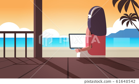 woman using laptop on tropical sea beach summer vacation online communication blogging concept rear view blogger sitting on wooden terrace seascape background horizontal 61648542