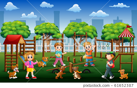 Children and friends playing in a public park with their pets 61652387