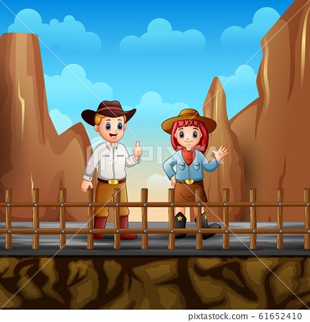 A cowboy and a cowgirl at the desert 61652410