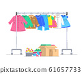Kids clothes and shoes on hanger rack for donation 61657733