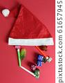 Santa hat on red art paper background. 61657945