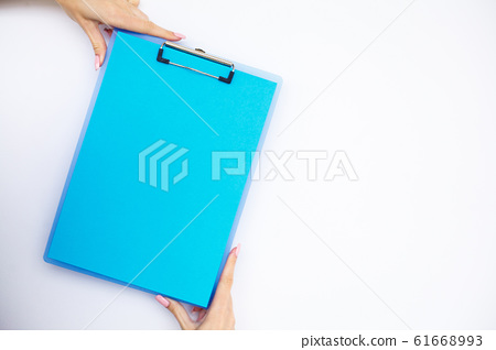 Blank Folder with Blue Paper. Hand that Holding Folder and Pen on White Background. Copyspace. Place for Text 61668993