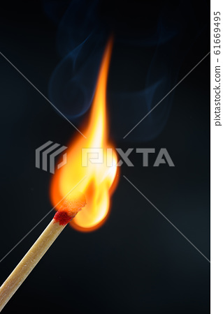 Match stick  ignited burning bright big fire flame with smoke on black background. 61669495