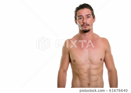 Studio shot of young handsome man shirtless isolated against whi 61676640