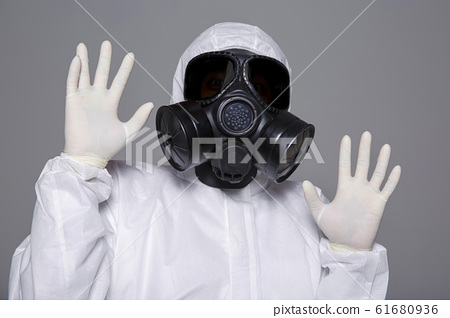 Male scientist in protective suit and antigas mask with glasses. 069 61680936