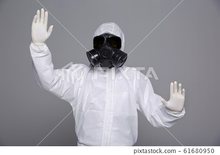 Male scientist in protective suit and antigas mask with glasses. 067 61680950