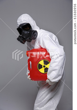 Male scientist in protective suit and antigas mask with glasses. 055 61680956