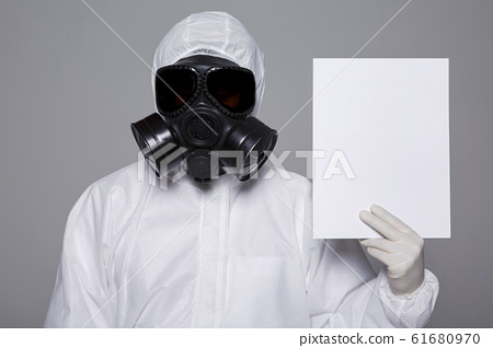 Male scientist in protective suit and antigas mask with glasses. 061 61680970