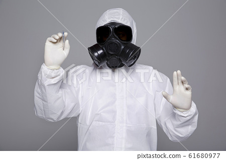 Male scientist in protective suit and antigas mask with glasses. 063 61680977