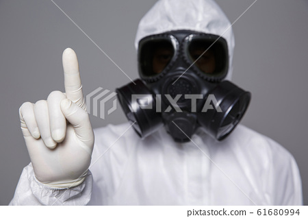 Male scientist in protective suit and antigas mask with glasses. 039 61680994