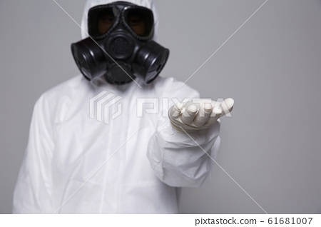 Male scientist in protective suit and antigas mask with glasses. 036 61681007