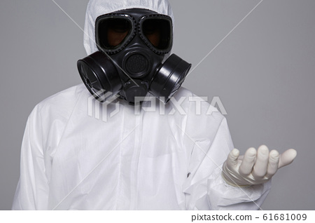 Male scientist in protective suit and antigas mask with glasses. 025 61681009