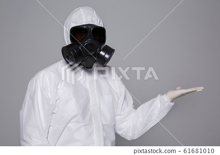Male scientist in protective suit and antigas mask with glasses. 024 61681010