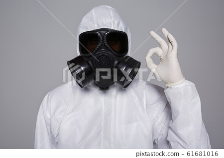 Male scientist in protective suit and antigas mask with glasses. 017 61681016