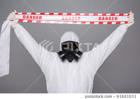 Male scientist in protective suit and antigas mask with glasses. 013 61681031