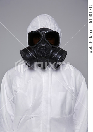Male scientist in protective suit and antigas mask with glasses. 012 61681039