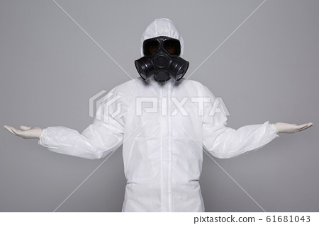 Male scientist in protective suit and antigas mask with glasses. 007 61681043