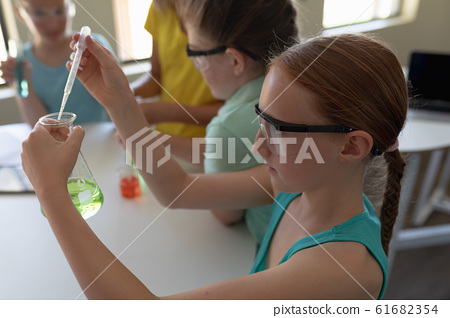 Group of elementary school kids in chemistry class 61682354