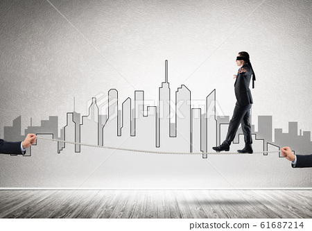 Business concept of risk support and assistance with man balancing on rope 61687214