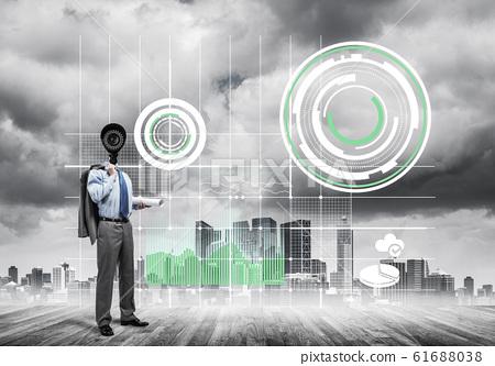 Camera headed man standing on wooden floor against modern citysc 61688038