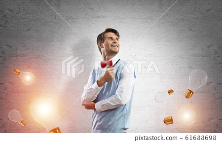 Conceptual image of young businessman. 61688698