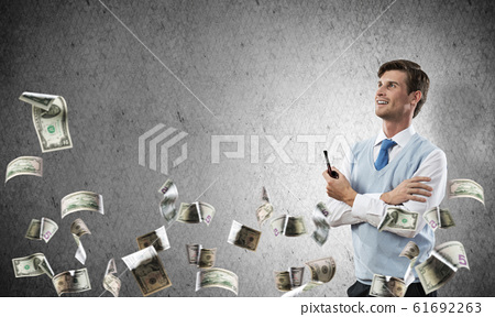 Conceptual image of young businessman. 61692263