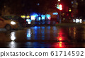 Window glass in rainy day. Bokeh night traffic lights 61714592