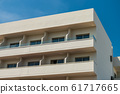 Modern new building with open balconies against the summer blue sky 61717665