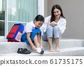 Asian mother watching her daughter preschool 61735175