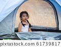 asian little girls alone playing in tent camping travel. 61739817