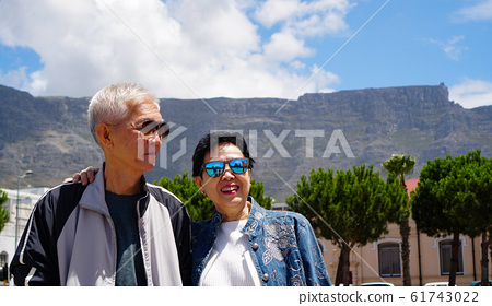 Asian elder couple retirement in South Africa good weather and nature city 61743022