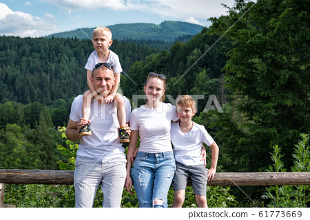 Family resting in nature. Mom, dad and two sons on 61773669