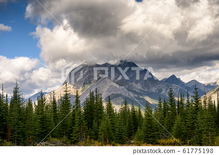 Commercial Helicopter flying with rocky mountains 61775198