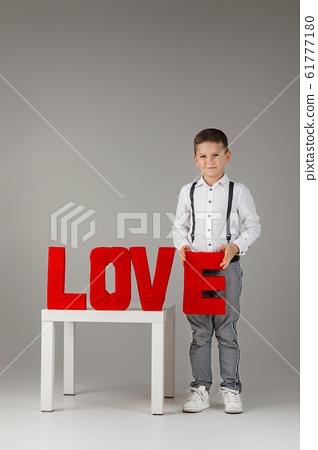 child boy holding holding red word LOVE 61777180