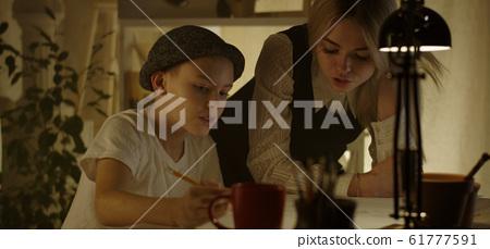 Teacher and student in art class 61777591