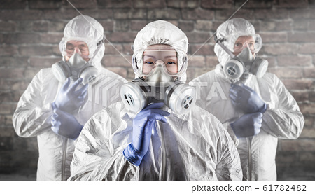 Chinese Woman and Team Behind In Hazmat Suits, 61782482