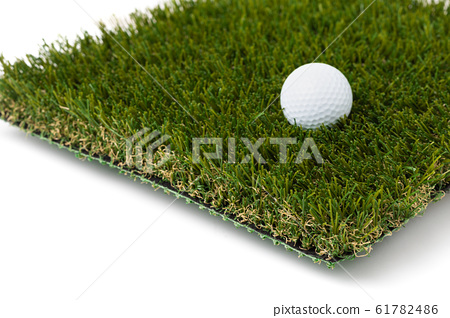 Golf Ball Resting on Section of Artificial Turf 61782486